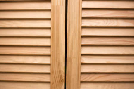 Wooden blinds panel. Vintage timber doors. Vintage home design.