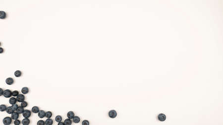 Raw blueberry frame on white background. Vegetarian food, blue berry crop