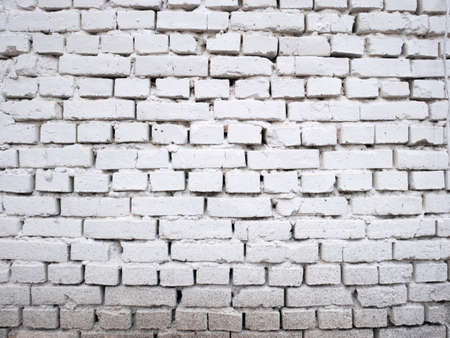 White brick wall background design. Building surface texture. Vintage cracked construction, stone wallpaper. Banco de Imagens