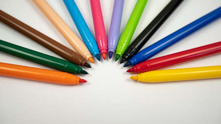 Different colors of felt pens on white background. Craft work design Banco de Imagens