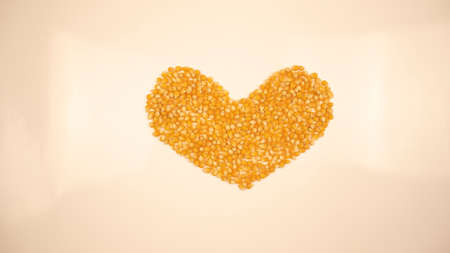 Pop corn maize heart. Dry popcorn. Healthy eating. Yellow grain agriculture