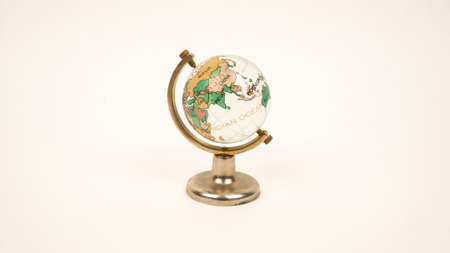 Glass globe on a white background. Transparent sphere, continents and oceans. China, Russia, India, Mongolia, Kazakhstan Pakistan Afghanistan Banco de Imagens