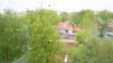 Rain drops on glass. Wet window with raindrops, nature background, transparent dropet