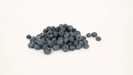 Raw blueberry pile on white background. Vegetarian food, blue berry crop