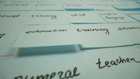 Learning english tags on stickers. Education training, blue adhesive sticky 版權商用圖片
