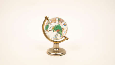 Glass globe on a white background. Transparent sphere, continents and oceans. Brazil, South America, Argentina, Colombia