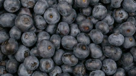 Raw blueberry background. Vegetarianism, blue berry crop 版權商用圖片
