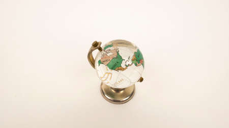 Glass globe on a white background. Transparent sphere, continents and oceans. North America, USA, Canada 版權商用圖片