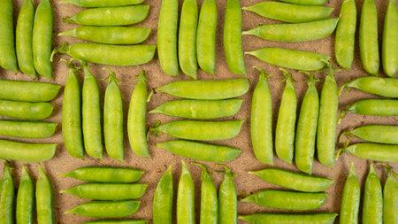 Green fresh peas background. Geometric pattern, vegetatian food harvesting