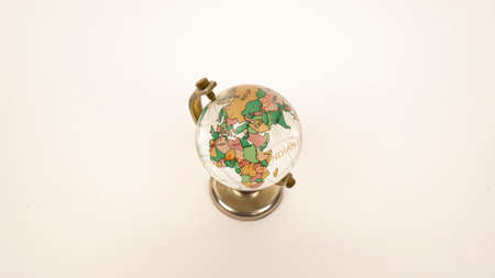 Glass globe on a white background. Transparent sphere, continents and oceans. Russia, Europe, Africa. 版權商用圖片