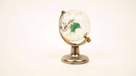 Glass globe on a white background. Transparent sphere, continents and oceans. Australia Archivio Fotografico