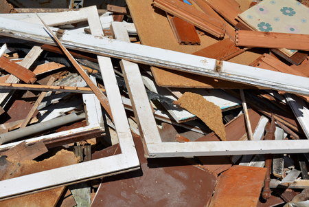 dumpster: A dumpster piled with scrap from a building