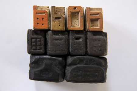 A photograph of wooden letterpress telephones and mobile phones