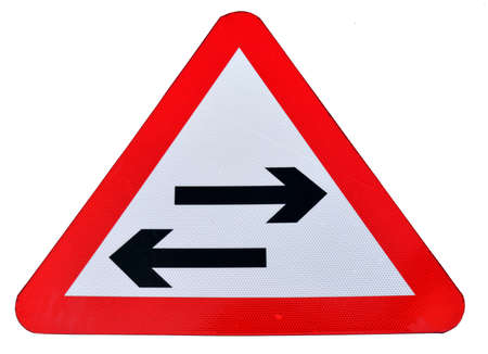 An isolated triangular traffic sign to indicate a two way tram line featuring right and left arrows
