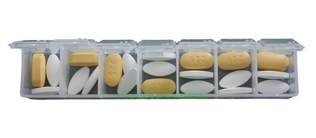 medicate: weekly container with pills Stock Photo