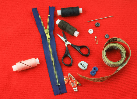 tailoring: Tailoring accessories on red cloth