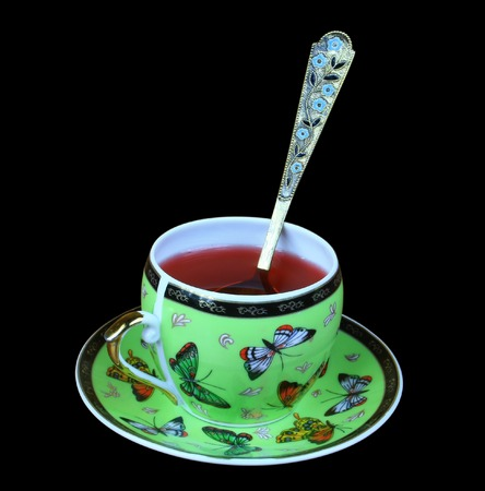 red tea: cup of red tea isolated on black background Stock Photo