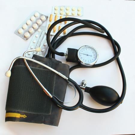 tonometer: tonometer and pills blood pressure theme Stock Photo