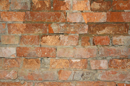 dilapidated wall: dilapidated wall of red brick