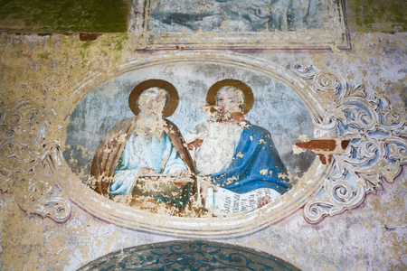 Old, dilapidated church painting in abandoned church