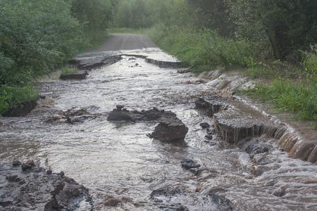Water flows through a dirt road