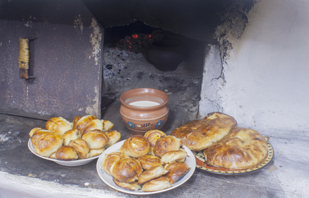 pies and milk in the Russian stove 写真素材