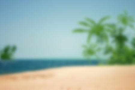 Summer holiday concept: concept: Abstract blur beach with yellow and blue sky sunrise background