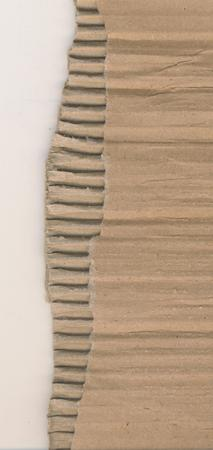 Natural brown craft paper background. Grunge corrugated paper with ragged edge. 免版税图像
