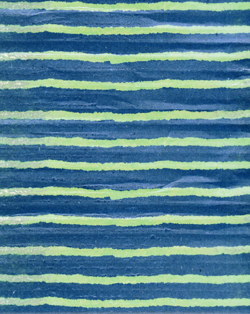 Natural color craft paper background. Grunge corrugated paper with ragged edge. Blue and white delicate lines and strips.