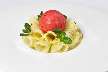 Pineapple carpaccio dessert watermelon sorbet white plate menu Stock Photo