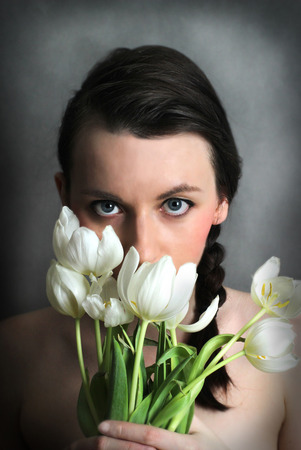 Brunette woman with flowers eyes photo