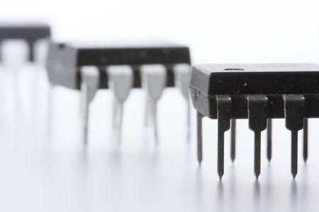 Three DIP-8 format op-amp (operational amplifiers) integrated circuits, on a white background.