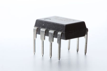 A DIP-8 op-amp (operational amplifier) integrated circuit, standing on a white background.