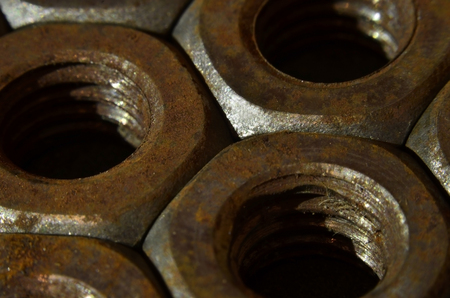 Closeup of a pile of rusty nuts