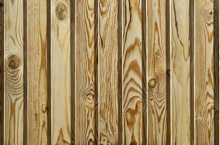 The texture of weathered wood plank fence
