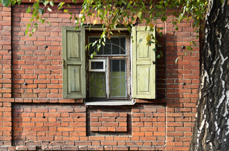 Window of an old Russian colorful village hut