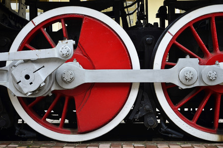 Wheels of an old black soviet steam train