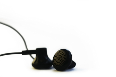 Small headphones isolated on a white background. Music listening concept