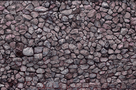 smeary: Stone wall background - building feature. Texture of thick and strong wall of rough stones of various shapes and sizes.