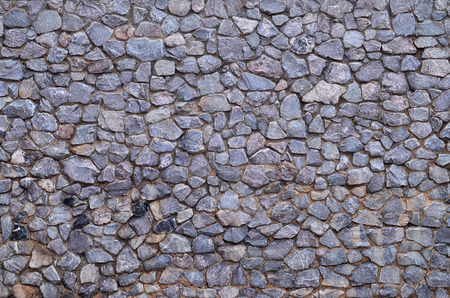 smeared: Stone wall background - building feature. Texture of thick and strong wall of rough stones of various shapes and sizes.