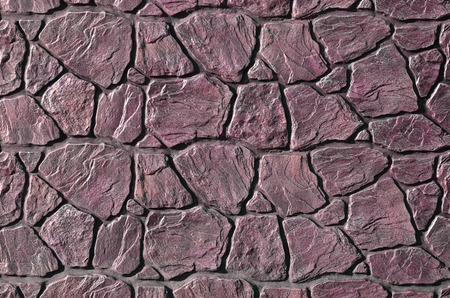 bedraggled: Stone fence texture - building feature. Texture of concrete fence with relief and texture like a stone wall
