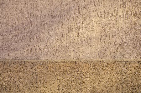 formalization: Concrete wall texture with colored plaster. Beautiful design facade painted plaster walls with small pits of various shapes. The texture for the walls in the interior or exterior Stock Photo