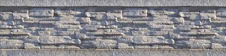 feature wall: Stone fence texture - building feature. Texture of concrete fence with relief and texture like a stone wall
