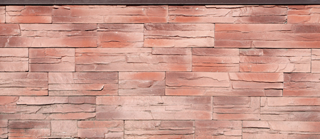 smeary: Brick slate texture - building feature. Texture of concrete fence or foundation with relief and texture like a weathered stone wall Stock Photo