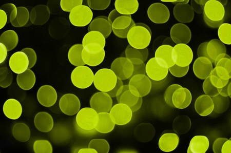 brightly: Abstract background image with bokeh effect. Many brightly colored circular shapes on a dark background. Stock Photo