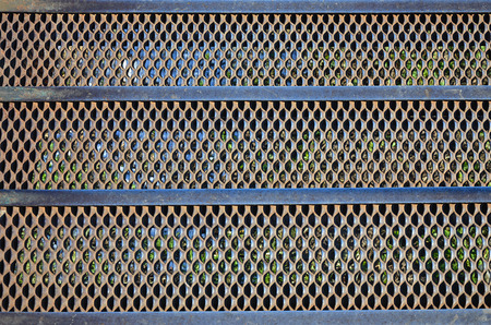 corrode: Texture steps of rusty metal mesh in the sections of the metal strips