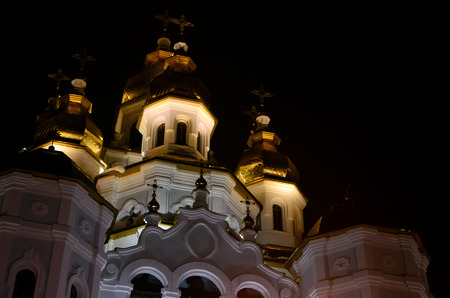 exaltation: Church of the Holy Myrrh-Bearers of the Mirror stream. Kharkiv. Ukraine. Detailed photo of Church with golden domes and relief decors at night Stock Photo