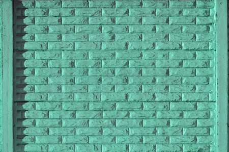 smeary: Stone fence texture - building feature. Texture of green concrete fence with relief and texture like a stone wall Stock Photo