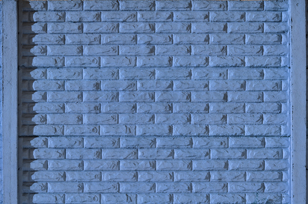 smeary: Stone fence texture - building feature. Texture of blue concrete fence with relief and texture like a stone wall Stock Photo