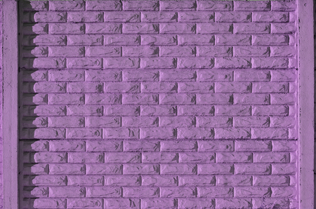 Stone fence texture - building feature. Texture of purple concrete fence with relief and texture like a stone wall